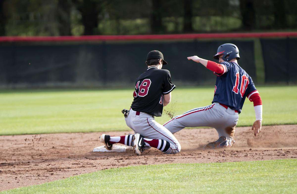 BA's Jack Victory (10) slides safely into second while Gabe Dillard tries to apply the tag.jpg