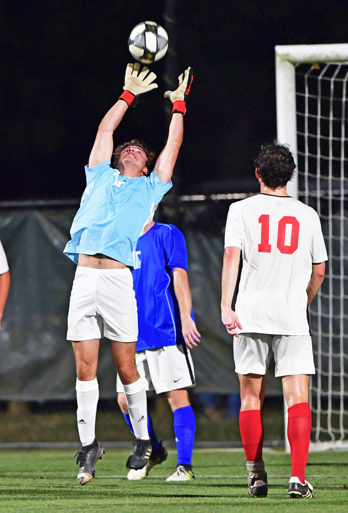 Andy Valles of Hunters Lane makes a save for team East. .jpeg