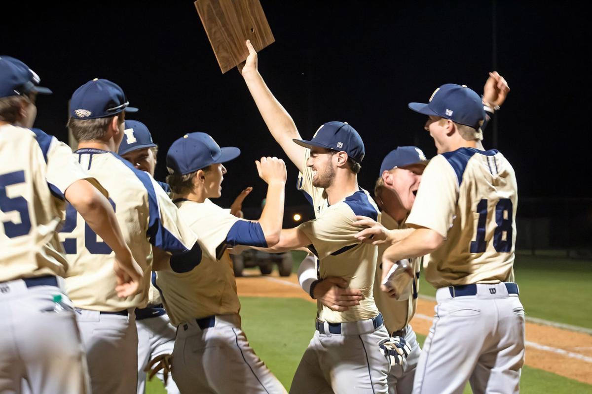 Independence celebrates with their D11-AAA tournament plaque.jpg