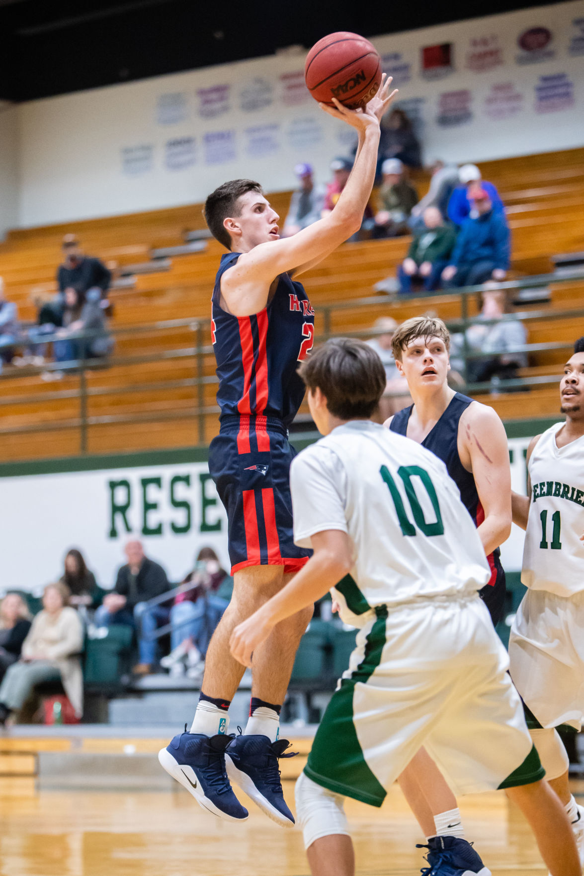 WH Heritage's Noah Owlsely shoots a jumper over the Greenbrier defense.JPG