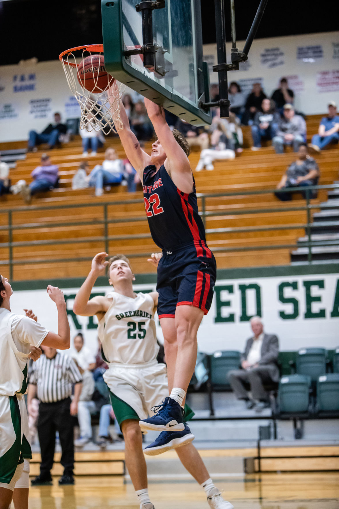 WH Heritage's Dylan Stephens finishes off a slam dunk.JPG