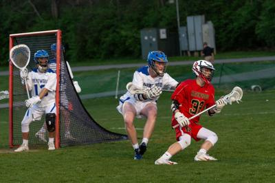 Ravenwood's Ben Elliott (32) tries a spin move to get to the Brentwood goal.jpg