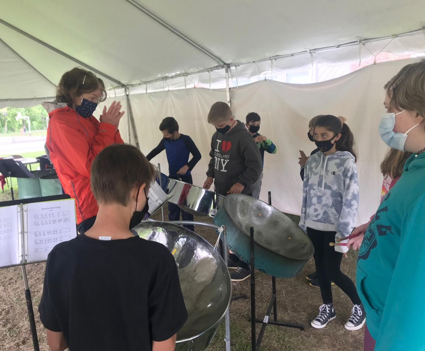 Calypso Connections Director, Jen Cohen, delights at the performance of her 5th grade steel drummers from MEMS. .jpg