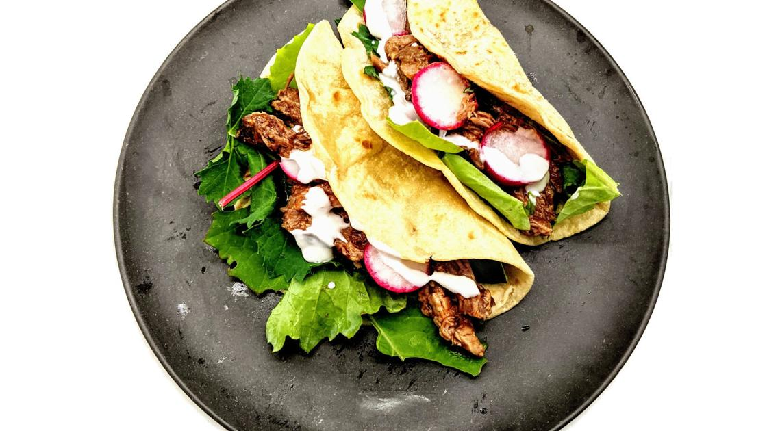 These slow cooker barbecue pulled pork tacos can help you beat the heat