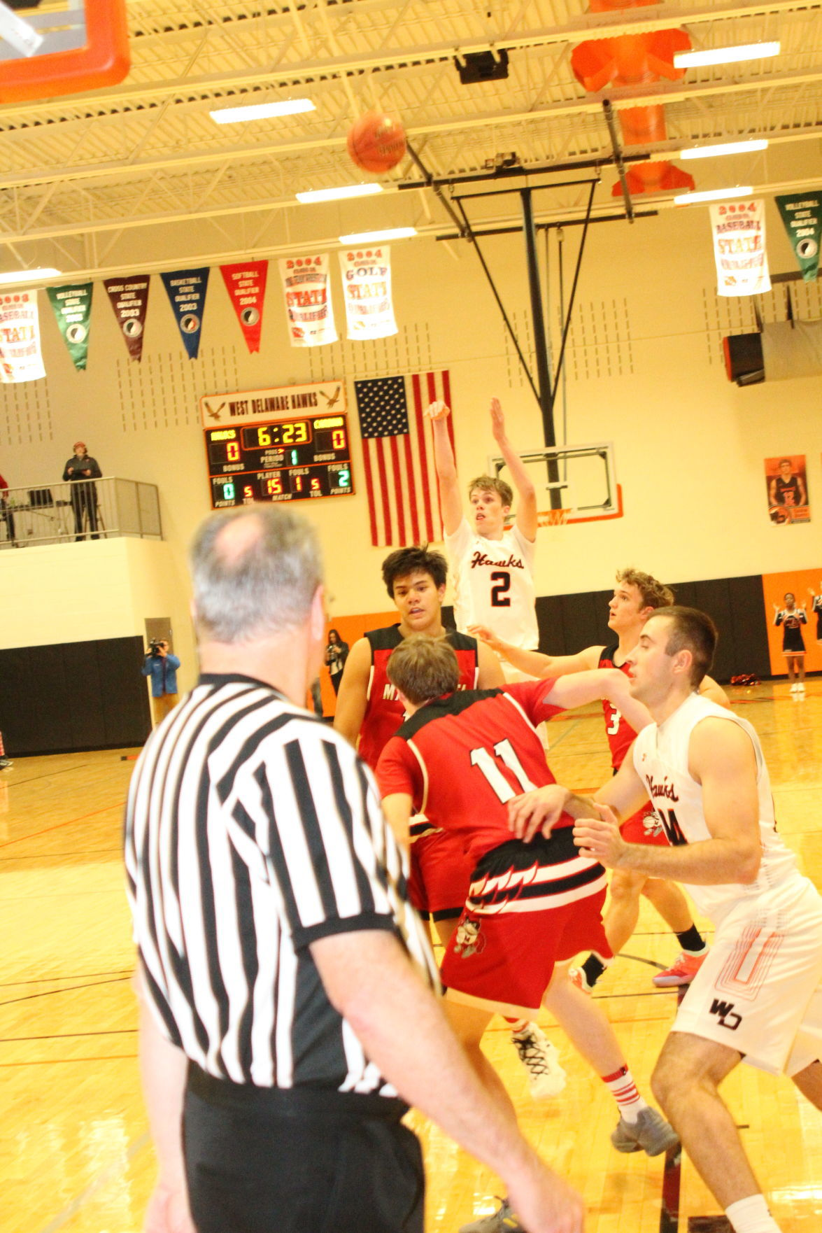 Kyle Kelley takes a shot from the top of the key against Maquoketa. The Cardinals handed the Hawks their first loss of the season, defeating them 40-35.