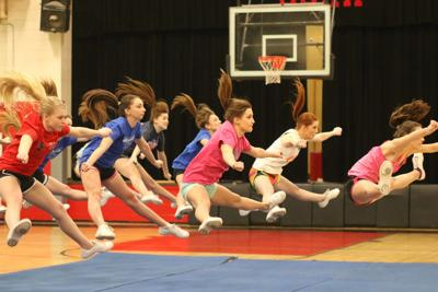 Blood, sweat and CHEER: CHS squad prepares for March cheer competition in Louisville