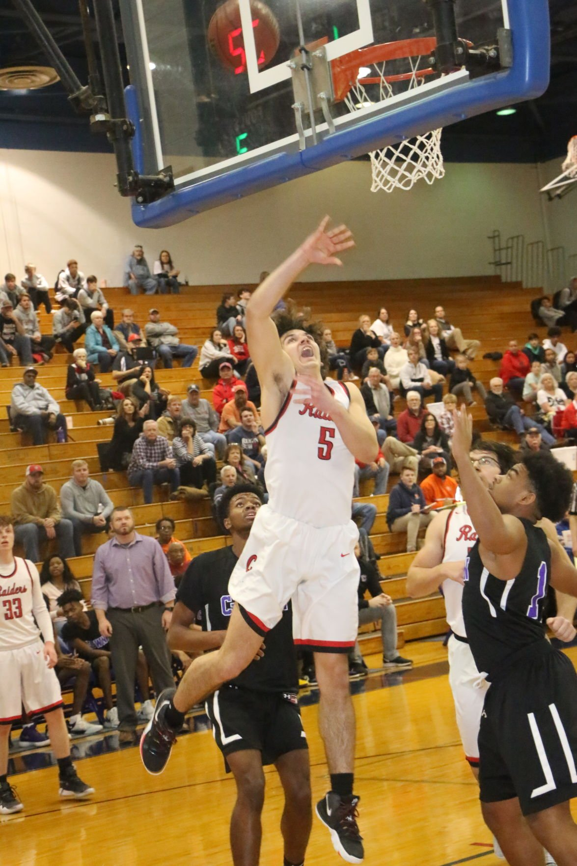 Coffee County men struggle to overcome three point barrage in loss to Columbia