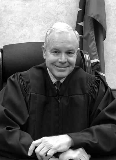 Three eye Judge Brock's seat