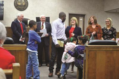 Father of six graduates, brings children home