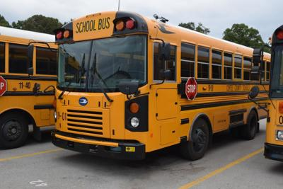 County officials discuss bus drivers' pay during shutdown, purchasing new buses