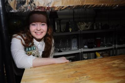 Girl Scout Gold: Local teen works toward Scout's highest award and sorts the MAC prop room