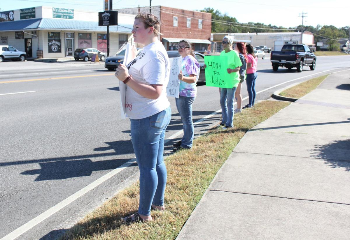 Several locals gathered at the intersection of Highway 55 and Highway 41 to protest bullying