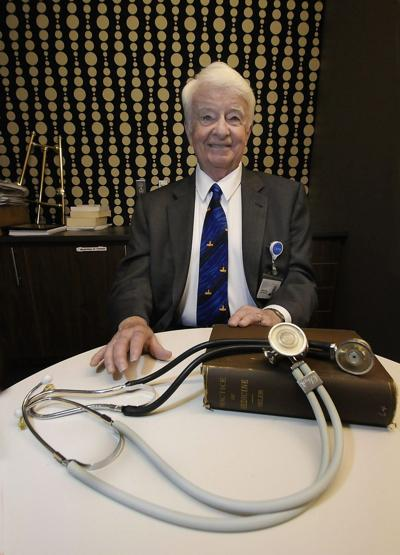 Educator assembling trove of medical artifacts, documents