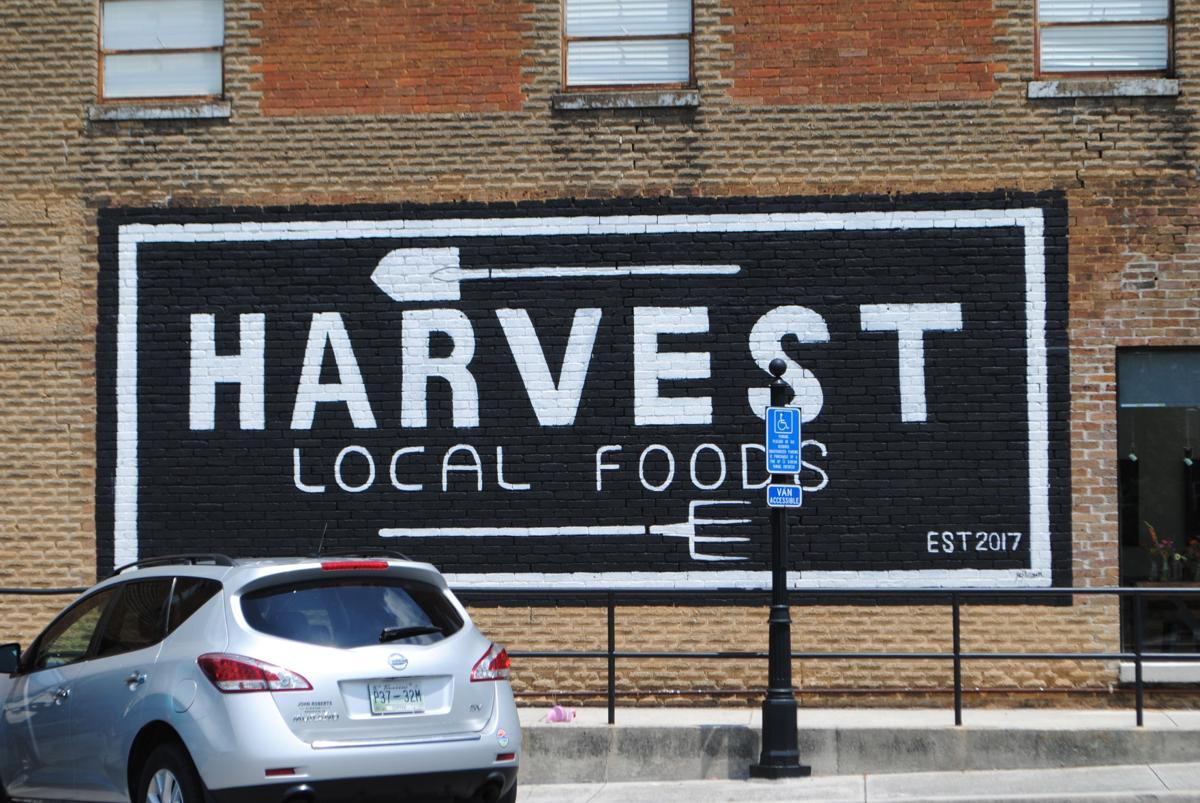 Harvest local food sign
