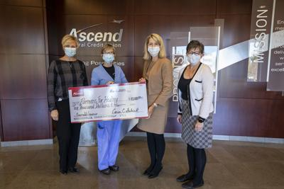 Ascend donates $10,000 to Partners for Healing