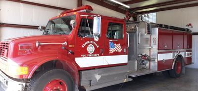 Finance committee lends hand to volunteer firemen