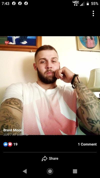 Law enforcement searches for murder suspect