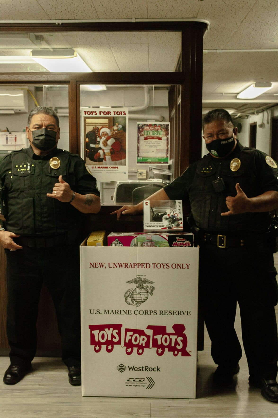 DPS officers posing next to donated toys.jpg
