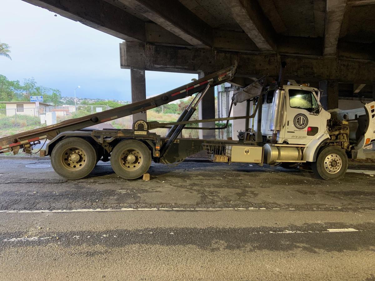 Truck hits overpass