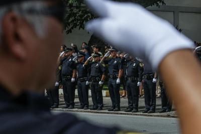 HPD officers saluting