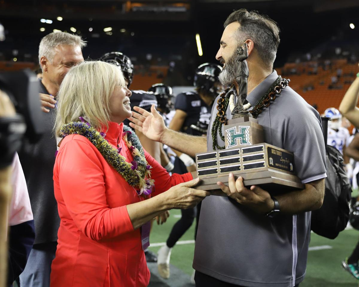 Tomey family hands Rolovich the trophy