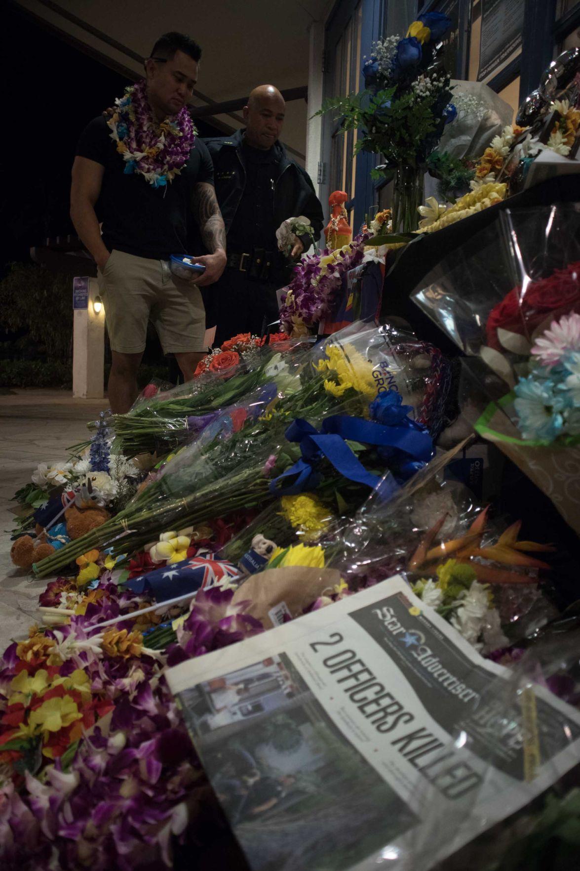 Jonathan Daniel Baba overlooking memorial for his girlfriend officer Tiffany Enriquez
