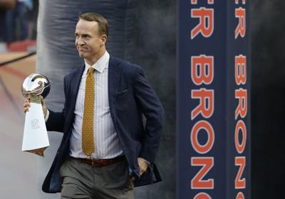 Watch Peyton Manning's Mardi Gras catch and throw along Iris parade route