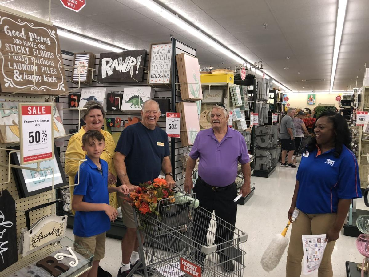 At Right Hobby Lobby Employee Sherice Williams Is Thrilled To Welcome Patrons Robert Wood And Charles Carolyn Dawson Their Grandson The Stores