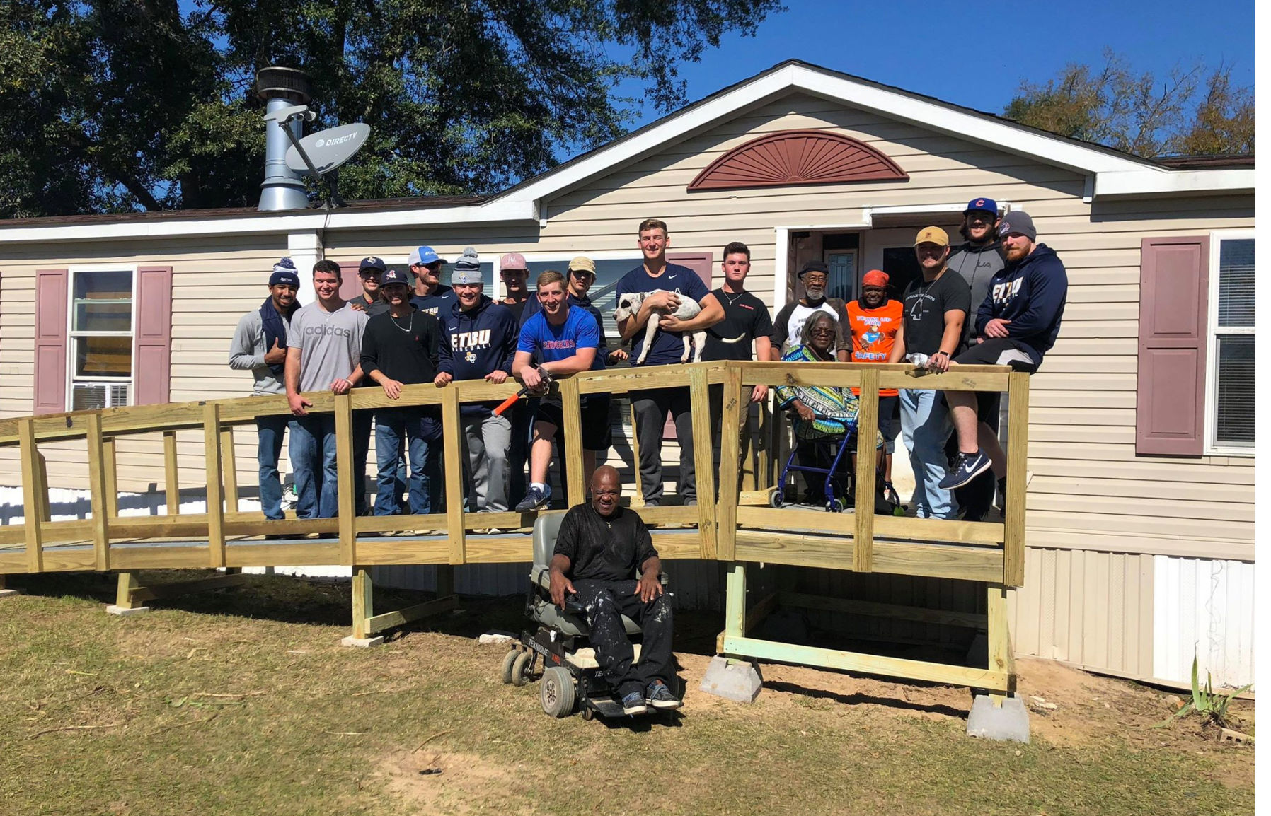 ... Wheelchair Ramp Team And East Texas Baptist Universityu0027s Baseball  Players Team Pose With A Marshall Family After Building A Free Ramp At  Their Home Last ...