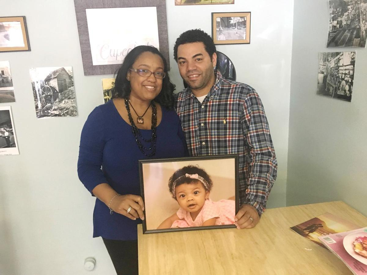 Lori Lowe-Bonds and  Marcus Bonds with photo of Layah