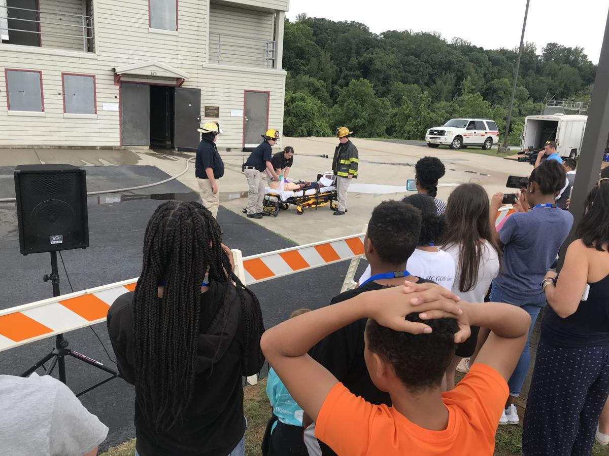 Students watch paramedics in action