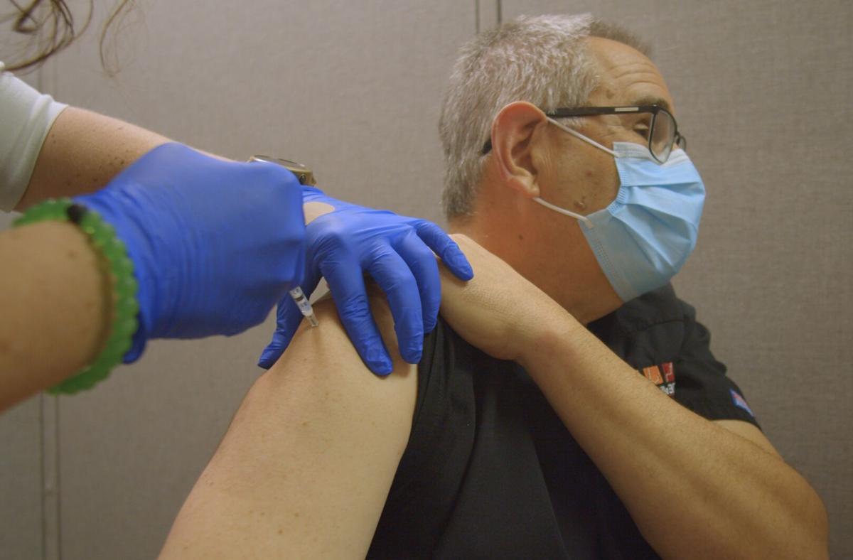 Dr. Richard Galos receives vaccine - Martinsville