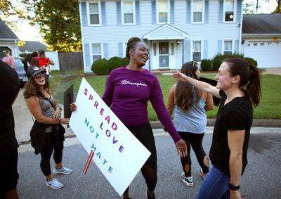 Jannique Martinez, center, is joined Friday by her Salem Lakes neighbors and supporters to protest the behavior of their neighbor.