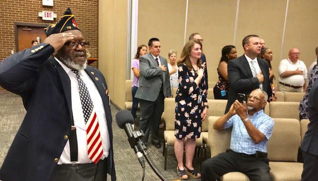 William T. Barksdale Jr. leads pledge at school board meeting