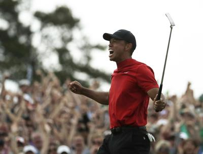 Tiger Woods reacts to winning The Masters Sunday