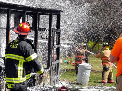 IMAGE: Shed fire threatens home, no injuries