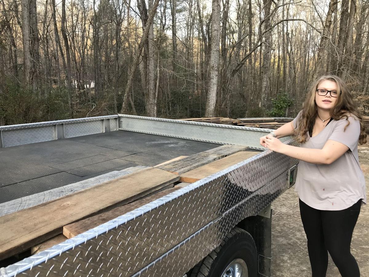 Local business donates antique lumber for school's art program
