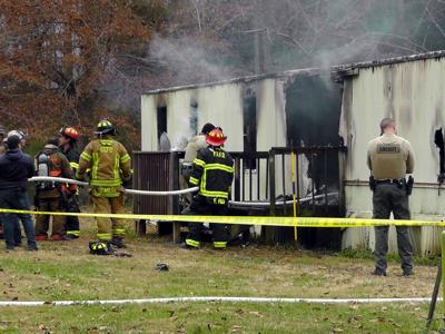 Emergency personnel investigate explosion at Old Fort home