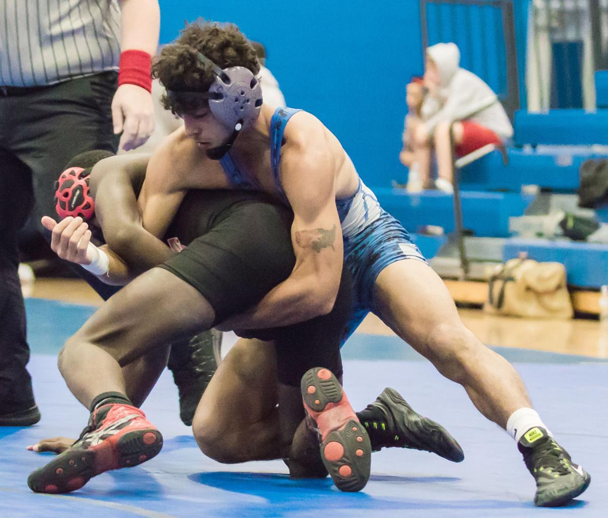 Quite a quad: Titans open wrestling season 3-0