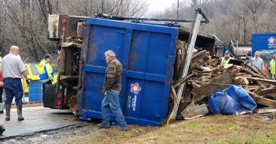 Truck overturns at convenience center south of Marion