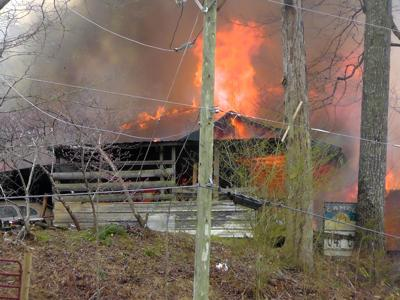 Home burns in Crooked Creek fire