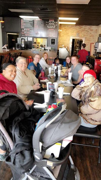 Local business hosts meal for parenting support group