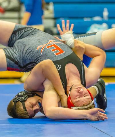 Titans hammer Cavaliers in wrestling season opener