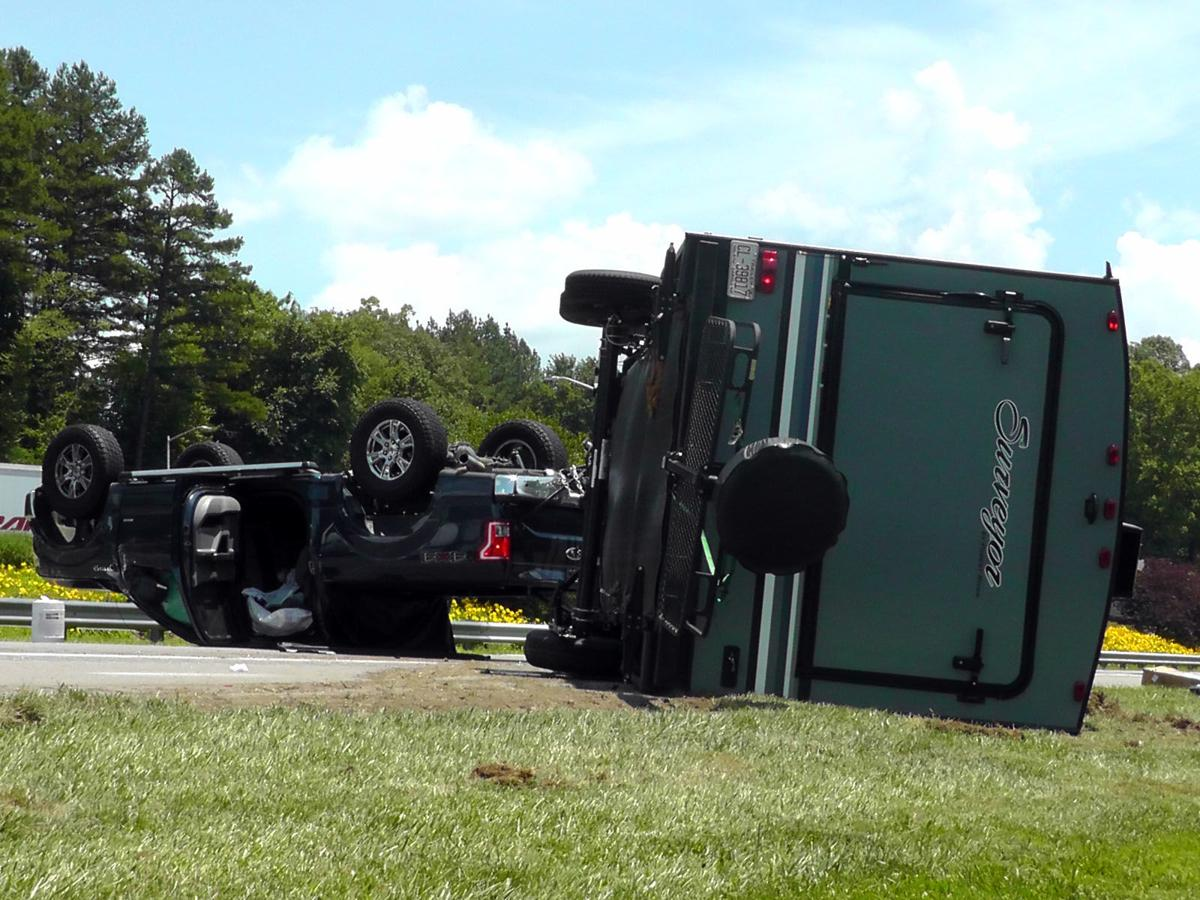 Truck, camper roll over in I-40 accident