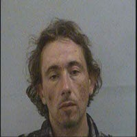 Man charged with stealing handcuffs he was wearing