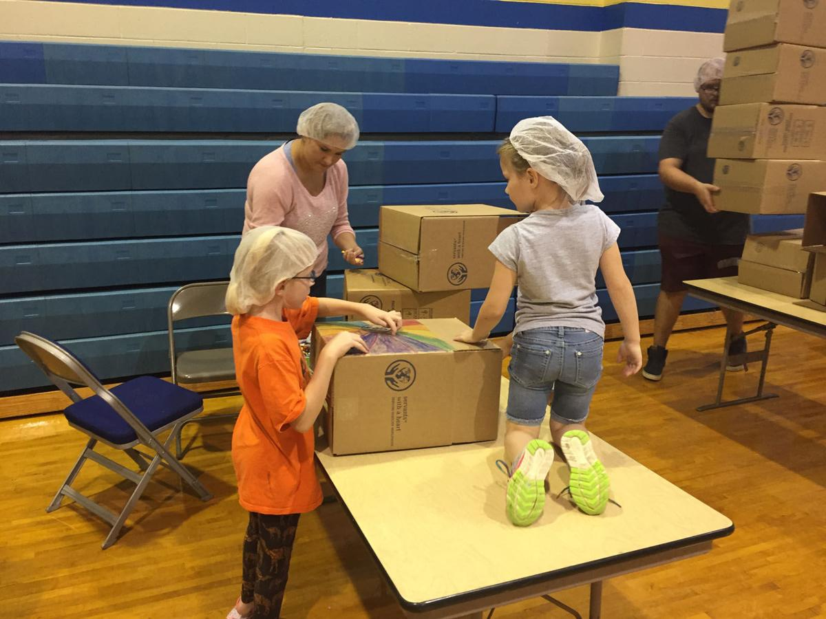 Hundreds of volunteers pack more than 100,000 meals