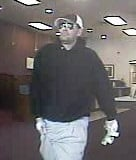 Authorities searching for Fifth Third Bank robbery suspect in Marion