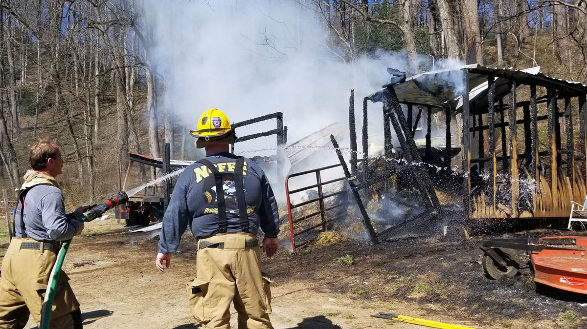 Hay barn, log truck burn in fire