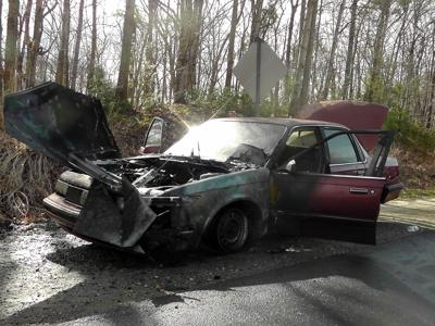 Car burns on I-40, sparks outside fire