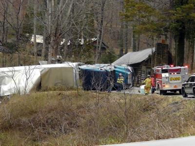Tractor trailer overturns into creek